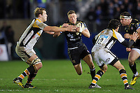 Rhys Priestland of Bath Rugby takes on the Wasps defence. European Rugby Champions Cup match, between Bath Rugby and Wasps on December 19, 2015 at the Recreation Ground in Bath, England. Photo by: Patrick Khachfe / Onside Images