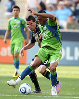 Sebastien Le Toux #9 of the Philadelphia Union moves in on Tyrone Marshall #14 of the Seattle Sounders FC during the first MLS match at PPL stadium in Chester, Pa. on June 27 2010. Union won 3-2.