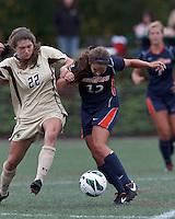 Pepperdine University defender Kristin DeGrandmont (12) passes the ball as Boston College defender McKenzie Meehan (22) defends. Pepperdine University defeated Boston College,1-0, at Soldiers Field Soccer Stadium, on September 29, 2012.