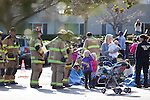 After fumes from a gas leak gave some of the students headaches Dec. 12, children at Union Presbyterian Church in Los Altos, CA were evacuated. Santa Clara County firefighters talk with children and parents after the incident.