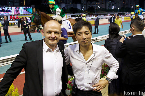 Geo photographer Justin Jin (Right) with writer Ariel Hauptmeier at the Hong Kong Jockey Club's Happy Valley racecourse.