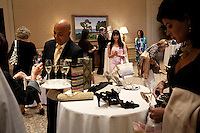 """Newport, California, July 22, 2011 - Comlimentary champagne was served during the opening night at The Divorcee Sale at the Pelican Hill Resort in Orange County. Organized by Jill Alexander, the sale offers luxury items most of which from uber-rich divorcees looking to unload their proverbial baggage. The event also donates 25 percent of its profits to breast cancer research...Alexander, who has actually never been married, started The Divorcee Sale this past spring after noticing a trend amongst her friends and colleagues going through divorces. """"Many women have an attachment to these things and they just want to move on,"""" says Alexander. She added that the consignment shops were full and not really offering much in the way of sympathy in the situation. Alexander is different in that she visits the home of the divorcees, often with cakes and tissues, and acts as both a consignor and a confidant. ."""