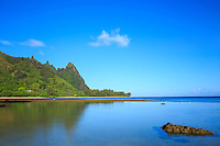 A clear and calm morning is reflected in the ocean at Tunnels Beach (or Makua Beach), North Kaua'i.