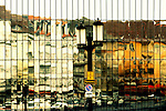 Abstract Reflection and mirror of houses and traffic of the district Berlin Charlottenburg in a mirror facade.