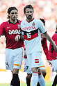 Matthew Spiranovic (Reds), Joshua Kennedy (Grampus), APRIL 24th, 2011 - Football : 2011 J.League Division 1 match between Urawa Red Diamonds 3-0 Nagoya Grampus Eight at Saitama Stadium 2002 in Saitama, Japan. The J.League resumed on Saturday 23rd April after a six week enforced break following the March 11th Tohoku Earthquake and Tsunami. All games kicked off in the daytime in order to save electricity and title favourites Kashima Antlers are still unable to use their home stadium which was damaged by the quake. Velgata Sendai, from Miyagi, which was hard hit by the tsunami came from behind for an emotional 2-1 victory away to Kawasaki. .(Photo by AFLO)