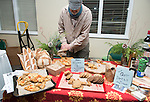 Bob O'neil, Co- owner of VIllage Bakery prepares samples for attendees of the annual WellWorks Winter Gathering. Photo by Ben Siegel