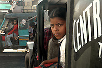 A school girl returning home by auto rickshaw at Hazipur. Hazipur is a small township near Sonepur where travelers can find rundown hotels. Bihar, India, Arindam Mukherjee.