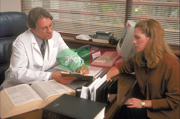 male doctor explaining diagnosis to female patient