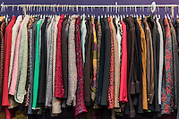 Women's jacket selection in a thrift shop.