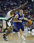 Dallas Mavericks' Dirk Nowitzki (R) drives to the basket against Seattle SuperSonics' Jerome James (L) in the first period of their game at the Key Arena in Seattle, Washington Wednesday, 13 April  2005.  Jim Bryant Photo. &copy;2010. All Rights Reserved.
