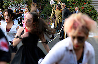 United States President Barack Obama and first lady Michelle Obama watch a flash mob  during a Halloween event at the South Lawn of the White House October 31, 2016 in Washington, DC. The first couple hosted local children and children of military families for trick-or-treating at the White House.<br /> Credit: Olivier Douliery / Pool via CNP /MediaPunch