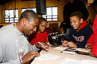 David Oliver signing autographs  for  young fans at the Tobin Community Center on Friday, February 22, 2008. Photo by Errol Anderson,TheSporting Image.