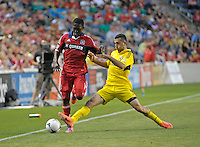 Columbus midfielder Justin Meram (9) lunges to knock the ball away from Chicago midfielder Patrick Nyarko (14).  The Chicago Fire defeated the Columbus Crew 2-1 at Toyota Park in Bridgeview, IL on June 23, 2012.