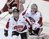 Chelsiea Goll (NU - 20), Chloe Desjardins (NU - 29) - The Northeastern University Huskies defeated Boston College Eagles 4-3 to repeat as Beanpot champions on Tuesday, February 12, 2013, at Matthews Arena in Boston, Massachusetts.