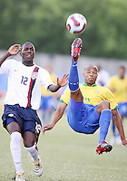 Josmer Altidore can only watch as Luizao clears with a scissors kick. USA stunned Brazil, winning 2-1 to finish first in their group. Final game in group D in Ottawa, Ontario, on JULY 6 2007.