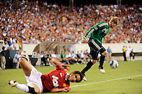 Philadelphia Union goalkeeper Brian Perk (24) plays the ball after colliding with Rafael (21) of Manchester United. Manchester United (EPL) defeated the Philadelphia Union (MLS) 1-0 during an international friendly at Lincoln Financial Field in Philadelphia, PA, on July 21, 2010.