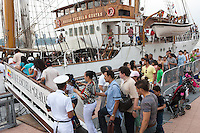 Visitors stand in line to board the Ecuadorian training ship BAE Guayas docked at the Intrepid pier during 2012 Fleet Week in New York City