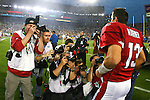 Kurt Warner is surrounded by photographers during Super Bowl XLIII at Raymond James Stadium on February 1, 2009 in Tampa, Florida. The Steelers defeated the Cardinals 27-23.  (AP Photo/Ben Liebenberg)