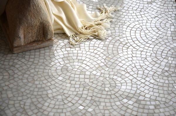 Surge, a hand-cut stone mosaic, shown in polished Calcatta.