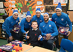 St Johnstone players took some festive cheer to Fairview School in Perth gving out selection boxes and gifts to the pupils&hellip;The players from left, Paul Paton, Zander Clark, Keith Watson, Alan Mannus and Joe Shaughnessy pictured with Ben a secondary school pupil who is massive St Johnstone fan who goes to games with his father<br />Picture by Graeme Hart.<br />Copyright Perthshire Picture Agency<br />Tel: 01738 623350  Mobile: 07990 594431