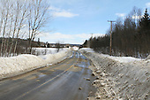 Early spring, snow starts to melt, leaving wet road conditions