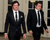 Rory McIlroy, Professional Golfer and Conor Ridge arrive for the Official Dinner in honor of Prime Minister David Cameron of Great Britain and his wife, Samantha, at the White House in Washington, D.C. on Tuesday, March 14, 2012..Credit: Ron Sachs / CNP.(RESTRICTION: NO New York or New Jersey Newspapers or newspapers within a 75 mile radius of New York City)