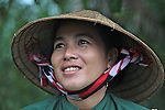 Yen, 36, sells grapefruit at the Cai Rang floating market in the Mekong Delta, south of Can Tho, Vietnam. Sept. 30, 2011.