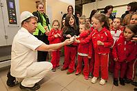 ASDA Newark baker Mark Smith shows the Rainbows some dough