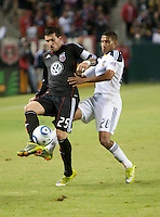 CARSON, CA – SEPTEMBER 18:  DC United midfielder Santino Quaranta (25) and LA Galaxy defender Sean Franklin (28) during a soccer match at Home Depot Center, September 18, 2010 in Carson California. Final score LA Galaxy 2, DC United 1.