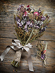 Rustic country wedding bouquet and boutonniere made of dried wild field flowers, artistic still life