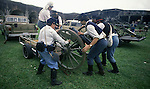 Union artillerymen unload a replica of a Civil War cannon from the back of a Chevy Truck before the Battle of Fort Morgan, Mobile, Al in 2001. Jim Bryant Photo. @2001. All Rights Reserved.