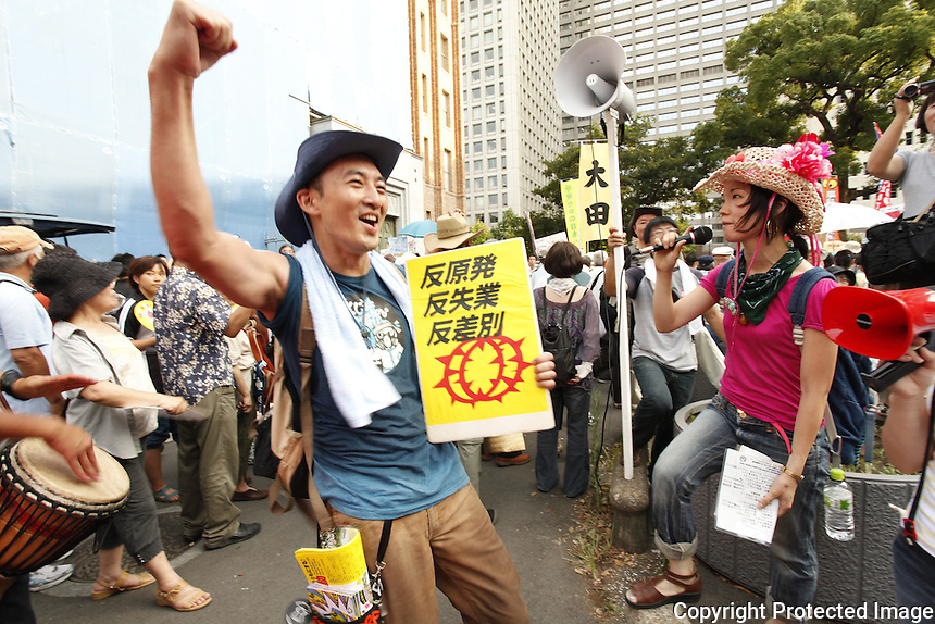 Anti-nuclear protestors chant, &ldquo;No more Hiroshima, no more Fukushima&rdquo; and other slogans as they march through the streets of Tokyo, ending with a rally in front of the national parliament (Diet) building. Initially police did not let protestors into the square in front of the building; then crowds surged through the barricades and filled the square for about 40 minutes until the rally ended peacefully. In Japan, where public protest is rare, weekly protests have been the largest demonstrations since the 1960s. Audio: Chifumi Sugano, a Tokyo housewife who became an activist after the disaster, explains a protest chant.<br /> ------------------- <br /> This photograph is part the book of Would You Stay?, by Michael Forster Rothbart, published by TED Books in 2013. The photos come from Forster Rothbart&rsquo;s two long-term documentary photography projects, After Chernobyl and After Fukushima.<br /> &copy; Michael Forster Rothbart 2007-2013.<br /> www.afterchernobyl.com<br /> www.mfrphoto.com &bull; 607-267-4893 &bull; 607-436-2856 <br /> 34 Spruce St, Oneonta, NY 13820<br /> 86 Three Mile Pond Rd, Vassalboro, ME 04989<br /> info@mfrphoto.com<br /> Photo by: Michael Forster Rothbart