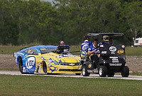 Apr. 26, 2013; Baytown, TX, USA: Crew members tow the car of NHRA pro mod driver Mike Janis during qualifying for the Spring Nationals at Royal Purple Raceway. Mandatory Credit: Mark J. Rebilas-