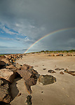A brilliant rainbow arching over Paine's Creek Beach in Brewster.