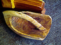 Carved wooden container or scoop on display at Bernice Pauahi Bishop Museum on Oahu. It was used on an outrigger canoe by early Hawaiians.