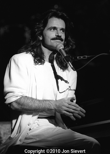 Yanni, Berkeley Community Theater, June 2, 1991, 102-3-15. Self-taught Greek-born pianist, keyboardist, and composer. After receiving a B.A. in psychology, he instead sought a life in music though he had no formal training and could not read a note.<br /> <br /> He earned Grammy nominations for his 1992 album, Dare to Dream, and the 1993 follow-up, In My Time. His breakthrough success came with the 1994 release of Yanni Live at the Acropolis, deemed to be the second best-selling music video of all time. Yanni has since performed live in concert before in excess of two million people in more than 20 countries around the world. He has accumulated more than 35 platinum and gold albums globally, with sales totaling over 20 million copies.