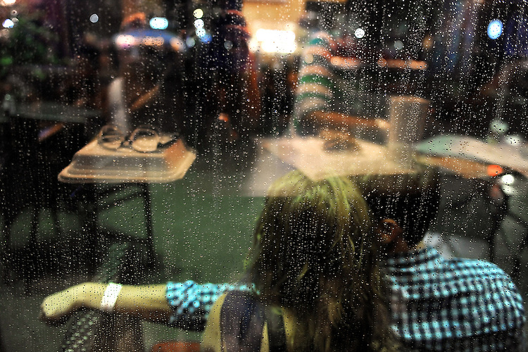 SEPTEMBER 8, 2012: Rain at City Plaza. Day three, Hopscotch 2012. (photo by Kim Walker, kimwalkerphoto.com)