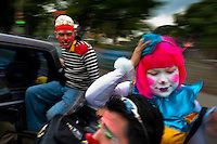Clowns from Guatemala go in an open car to the Clown Congress in San Salvador, El Salvador, 18 May 2011. The clown performance is considered a regular job in most of Latin American countries. Clowns may work individually or in groups, often performing advertisement like acts in large open-to-street shops or they take part in private shows, like children birthdays, family events etc. There are many clown conventions all over Latin America where clowns gather and exchange their experiences offering workshops of the comic acting or the art of make-up. For some of them, being clown is a serious lifetime profession.