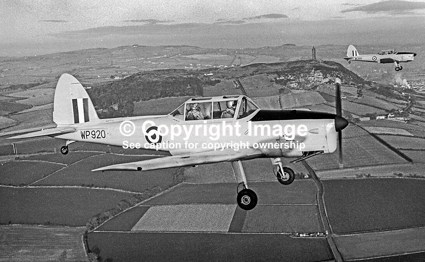 Chipmunks of the University Air Squadron at Queen's University, Belfast, N Ireland, fly over the Co Down Hills, passing Scrabo Tower, during a flight from the then Sydenham Airfield, now Belfast City George Best Airport. The photograph was taken 16th December 1969. Formed 8th January 1941 at Sydenham it was finally disbanded on 31 July 1996. 196912160262d<br /> <br /> Copyright Image from Victor Patterson, 54 Dorchester Park, Belfast, UK, BT9 6RJ<br /> <br /> t1: +44 28 9066 1296 (from Rep of Ireland 048 9066 1296)<br /> t2: +44 28 9002 2446 (from Rep of Ireland 048 9002 2446)<br /> m: +44 7802 353836<br /> <br /> e1: victorpatterson@me.com<br /> e2: victorpatterson@gmail.com<br /> <br /> The use of my copyright images is subject to my Terms &amp; Conditions.<br /> <br /> It is IMPORTANT that you familiarise yourself with them. They are available on my website at www.victorpatterson.com.<br /> <br /> None of my copyright images may be used on a website unless they are visibly watermarked, i.e. &copy; Victor Patterson within the body of the visible image. Metadata denoting my copyright must NOT be deleted. <br /> <br /> Web use is extra at currently recommended NUJ rates.