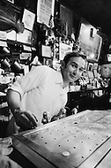 August 1970, Manhattan, New York City, New York State, USA --- The owner and manager of McSorley's Old Ale House in Manhattan bartending in 1970. McSorley's was New York City's oldest bar and refused female patrons before 1970. --- Image by © JP Laffont/Sygma/CORBIS