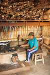 Bali, Indonesia; coffee beans being roasted over a fire in a thatched hut