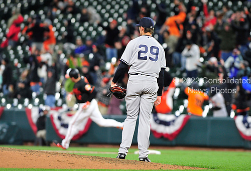 New York Yankees relief pitcher Tyler Clippard (29) watches as Baltimore Orioles right fielder Seth Smith (12) as he rounds first base after hitting the game-winning 2 run home run in the seventh inning at Oriole Park at Camden Yards in Baltimore, MD on Friday, April 7, 2017.  The Orioles won the game 6 - 5.<br /> Credit: Ron Sachs / CNP<br /> (RESTRICTION: NO New York or New Jersey Newspapers or newspapers within a 75 mile radius of New York City)