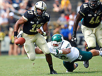 WEST LAFAYETTE, IN - SEPTEMBER 15:  Quarterback Austin Parker #17 of the Purdue Boilermakers runs away from the tackle of defensive lineman Pat O'Connor #52 of the Eastern Michigan Eagles at Ross-Ade Stadium on September 15, 2012 in West Lafayette, Indiana. (Photo by Michael Hickey/Getty Images)***Local Caption***Austin Parker; Pat O'Connor