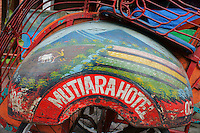 close-up of painted bemo (three-wheel taxi) showing a with rice field scene,   Yogyakarta, island Java, archipelago of Indonesia,  September 2011