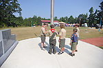Boy Scouts raise the flag at the dedication of the new Veterans Park in Oxford, Miss. on Saturday, June 30, 2012.