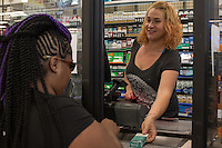 Cashier Lindsay Abdullah (CQ) sells Newport Cigarettes to a customer at Penny Saver Food and Gas, 2715 S Elm-Eugen Street, Greensboro, NC on Monday, July 11, 2016. (Justin Cook for The Wall Street Journal)<br /> <br /> TOBACCO<br /> <br /> Story Summary: Japan Tobacco Inc. is quietly invading U.S. tobacco country with a new discount cigarette brand. At Penny Saver Food and Gas near downtown Greensboro, N.C., the company&rsquo;s LD cigarettes have prime placement, around eye level in the middle of the section, allowing them to stand out alongside established brands like Marlboro, Newport and Camel. Its $2.81 price tag compares favorably with Marlboro at $5.25 and puts it in position to challenge discount brands L&amp;M at $3.69 and Pall Mall at $3.73. The red, blue, green and silver packs of cigarettes with the LD logo stamped on the right corner are part of a plan to give the world&rsquo;s second-largest tobacco company a toehold in the lucrative U.S. market. Almost all of Japan Tobacco&rsquo;s roughly $21 billion in sales comes from outside the U.S. LD is the first global brand the company introduced in the U.S. in March. The company said it is testing the discount cigarette&rsquo;s appeal in North Carolina and South Carolina and will launch the brand nationwide depending on its performance as early as next year with 10 style variations. Japan Tobacco&rsquo;s investment in LD is part of an about face for Big Tobacco. After years of spurning the U.S. because of mounting civil suits, international tobacco companies are returning as the country becomes more attractive than international markets. Legal risks here are fading and prices are rising. Plus, thanks to the First Amendment, companies here are protected from having to use plain packaging or apply graphic warning labels that show images of gangrene feet, rules currently gaining momentum worldwide. The Tokyo-based company has increased its staff in the U.S. by 20% over the past five years to 147 employees and inv