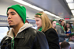March 16, 2013 - New York, NY, U.S. - Though the Long Island Rail Road added extra trains to Penn Station the day of the 252nd annual NYC St. Patrick's Day Parade, passengers had to stand in the aisles in some cars. Thousands of marchers showed their Irish pride, as they marched up Fifth Avenue, and over a million people watched and celebrated.
