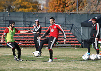 WASHINGTON, DC - NOVEMBER 14, 2012: Coaches Ben Olsen and Chad Ashton watch Daniel Woolard (21) and Hamdi Salihi (9) of DC United during a practice session before the second leg of the Eastern Conference Championship at DC United practice field, in Washington, DC on November 14.