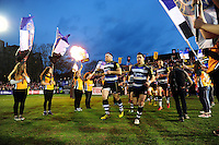 Henry Thomas, Horacio Agulla and the rest of the Bath Rugby team run out onto the field. Aviva Premiership match, between Bath Rugby and Saracens on April 1, 2016 at the Recreation Ground in Bath, England. Photo by: Patrick Khachfe / Onside Images