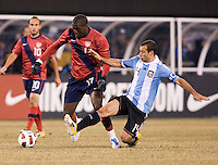 Jozy Altidore (17) of the United States is tackled by Javier Mascherano (14) of Argentina during an international friendly at New Meadowlands Stadium in East Rutherford, NJ.  The United States tied Argentina, 1-1.